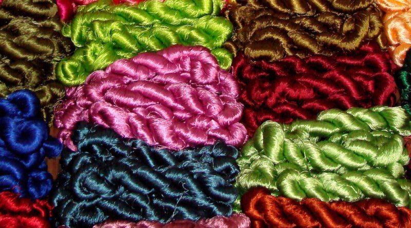 Graphene fed silkworms spin tough electrically conductive silk