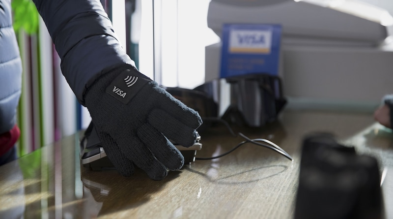 visa creates gloves collectible pins and stickers for wireless purchases at winter olympics - Visa creates gloves, collectible pins and stickers for wireless purchases at Winter Olympics